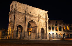 Arch of Constantine  at night. Arch of Constantine with the Colosseum in background at night Stock Photography