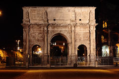 Arch of Constantine  at night. Arch of Constantine with the Colosseum in background at night Royalty Free Stock Image