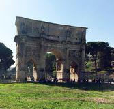 Arch of Constantine Roma. The Arch of Constantine is a triumphal arch in Rome, situated between the Colosseum and the Palatine Hill. It was erected by the Roman Stock Photo