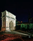 Arch of Constantine at Roman Forum in Rome in Italy. Arch of Constantine, Roman Forum in Rome in Italy late at night. Illuminated with light. Specially toned in Royalty Free Stock Photo