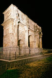 Arch of Constantine Roman Forum in Rome in Italy. Arch of Constantine, Roman Forum, in Rome in Italy late at night. Illuminated with light. Specially toned in Stock Image