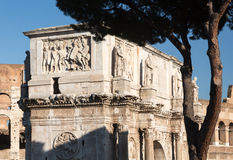 Arch of Constantine in Rome. Detail of arch of Constantine and Colosseum in Ancient Rome Stock Photography