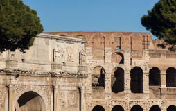 Arch of Constantine in Rome. Detail of arch of Constantine and Colosseum in Ancient Rome Stock Images