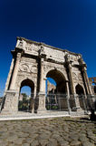 Arch of Constantine in Rome. The ancient Roman Arch of Constantine is a triumphal arch situated between the Colosseum and the Palatine Hill. It commemorates Stock Photos
