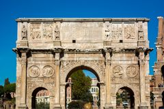 The arch of constantine in rome. On blue sky background Stock Photo