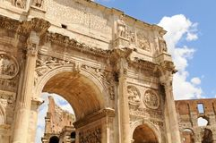 Arch of Constantine in Rome. Arch of Constantine framing Colosseum on a sunny day in Rome, Italy Royalty Free Stock Photo