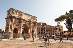Arch of Constantine in Rome, Italy. Tourists near the arch of Constantine in Rome, Italy  The Arch of Constantine is a triumphal arch in Rome, situated between Royalty Free Stock Photography