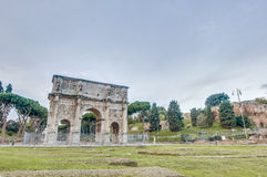 Arch of Constantine in Rome, Italy. Arch of Constantine (Arco di Costantino), a triumphal arch in Rome, located between the Colosseum and the Palatine Hill Stock Photography
