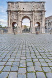 Arch of Constantine in Rome, Italy. Arch of Constantine (Arco di Costantino), a triumphal arch in Rome, located between the Colosseum and the Palatine Hill Stock Photos