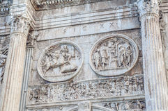 Arch of Constantine in Rome, Italy. Arch of Constantine (Arco di Costantino), a triumphal arch in Rome, located between the Colosseum and the Palatine Hill Royalty Free Stock Images