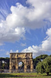 The Arch of Constantine, Rome, Italy. Arch of Constantine on the background of bright blue sky with unusual clouds, Rome, Italy Stock Photography
