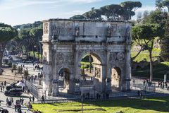 Arch of Constantine in Rome, Italy. Rome, Italy - December 31, 2016: Arch of triumph known as Arch of Constantine full of tourists in Rome, Italy in Rome, Italy Stock Photos