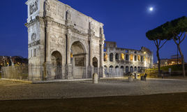 Arch of constantine rome italy europe. Night view of the 'arch of constantine in rome with the colosseum and the moon Stock Photo