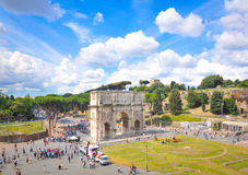 Arch of Constantine in Rome, Italy. Rome, Italy - June 19, 2016: Tourists visit the Roman vestiges of the Arch of Constantine, major touristic attraction in Rome Royalty Free Stock Photos