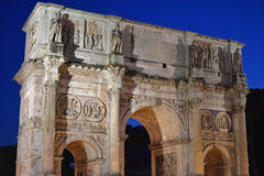 The Arch of Constantine, Rome. The Arch of Constantine in Italy, Rome, lit up at night Royalty Free Stock Image