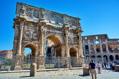 The Arch of Constantine. ROME, ITALY - MAY 17, 2017: The Arch of Constantine in Rome, with the Coliseum in the background Royalty Free Stock Photo