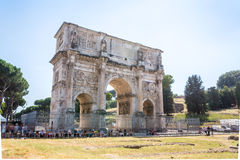 Arch of Constantine, Rome, Italy. Arch of Constantine and resting tourists nearby, Rome, Italy Royalty Free Stock Photography