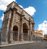 Arch of Constantine. ROME, ITALY - SEPTEMBER 24, 2015 : View of historical Triumphal Arch of Constantine, built in 315 AD in Rome, on cloudy blue sky background Stock Photos