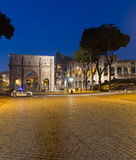 Arch of Constantine. ROME, ITALY - 11TH MARCH 2015: The Arch of Constantine near the Colosseum at night. A police car can be seen near the arch and the blur of Royalty Free Stock Photo