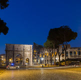Arch of Constantine. ROME, ITALY - 11TH MARCH 2015: The Arch of Constantine near the Colosseum at night. A police car can be seen near the arch and the blur of Stock Images