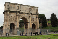 The Arch of Constantine, Rome, Italy. The Arch of Constantine is a triumphal arch in Rome, situated between the Colosseum and the Palatine Hill. It was erected Royalty Free Stock Photo