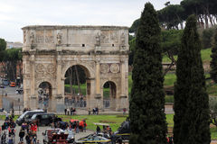 The Arch of Constantine, Rome, Italy. The Arch of Constantine is a triumphal arch in Rome, situated between the Colosseum and the Palatine Hill. It was erected Royalty Free Stock Images