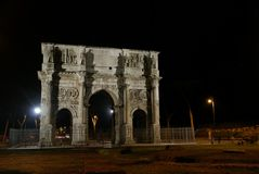 The Arch of Constantine, Rome, Italy. The Arch of Constantine is a triumphal arch in Rome, situated between the Colosseum and the Palatine Hill. It was erected Stock Photo