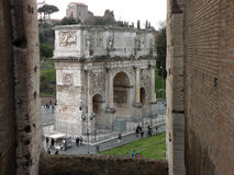 Arch of Constantine in Rome, Italy. View from the Roman Coliseum on the triumphal Arch of Constantine located in Rome, Italy Royalty Free Stock Image