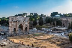 Arch of Constantine in Rome at sunset. Rome, Italy - August 21, 2016: High angle view of the Arch of Constantine from the Colosseum at sunset a sunny day of Royalty Free Stock Image
