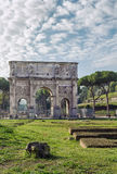 Arch of Constantine, Rome. The Arch of Constantine is a triumphal arch in Rome, situated between the Colosseum and the Palatine Hill, Italy Royalty Free Stock Images