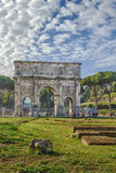Arch of Constantine, Rome. The Arch of Constantine is a triumphal arch in Rome, situated between the Colosseum and the Palatine Hill, Italy Royalty Free Stock Image