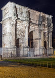 Arch of Constantine, Rome. The Arch of Constantine is a triumphal arch in Rome, situated between the Colosseum and the Palatine Hill, Italy, Evening Royalty Free Stock Images