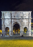 Arch of Constantine, Rome. The Arch of Constantine is a triumphal arch in Rome, situated between the Colosseum and the Palatine Hill, Italy, Evening Stock Image