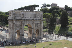 Arch of Constantine in Rome. The Arch of Constantine is a triumphal arch in Rome, situated between the Colosseum and the Palatine Hill. It was erected by the Stock Photo