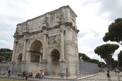 Arch of Constantine in Rome. The Arch of Constantine is a triumphal arch in Rome, situated between the Colosseum and the Palatine Hill. It was erected by the Royalty Free Stock Photos