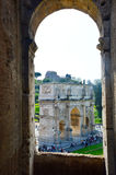 Arch of Constantine seen from the inside of Colosseum, Rome Italy Arco di Costantino.  Royalty Free Stock Images