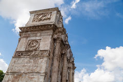 Arch of Constantine. Side view of historical Triumphal Arch of Constantine, built in 315 AD in Rome, on cloudy blue sky background Royalty Free Stock Image