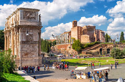 Arch of Constantine and temple of Venus in Rome. ROME, ITALY - OCTOBER 4, 2012: Arch of Constantine and temple of Venus. In Rome, there are many ancient Stock Photo