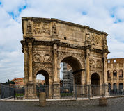 Arch of Constantine is triumphal arch in Rome. Arch of Constantine is a triumphal arch in Rome, situated between Colosseum and Palatine Hill. Erected by Roman Royalty Free Stock Photography