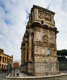 Arch of Constantine is triumphal arch in Rome. Arch of Constantine is a triumphal arch in Rome, situated between Colosseum and Palatine Hill. Erected by Roman Royalty Free Stock Photos