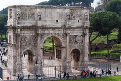 Arch of Constantine seen from the Coliseum. The Arch of Constantine is a triumphal arch that lies between the Colosseum and the Palatine Hill, in Rome Royalty Free Stock Photo