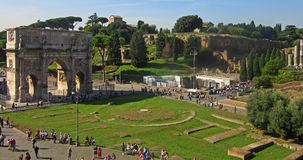 Arch of Constantine 2. The Arch of Constantine is a triumphal arch in Rome, situated between the Coliseum and the Palatine Hill. It was erected by the Roman Royalty Free Stock Photo