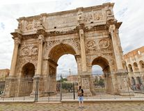 Arch of Constantine, Rome. The Arch of Constantine is a triumphal arch in Rome, situated between the Colosseum and the Palatine Hill. It was erected by the Roman Stock Photos