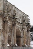 Arch of Constantine under snow. ROME - FEB 4: Arch of Constantine after the heavy snowfall on February 4, 2012 in Rome. The last snowfall in Rome was in 1985 Royalty Free Stock Photo