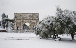 Arch of Costantine under snow. This picture was taken february 4th 2012, after one of the heaviest snowfall in Rome since 1985. This is the historic center of Royalty Free Stock Photos