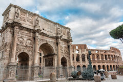 Arch of Costantino of Rome in Italy. ROME, ITALY - FEBRUARY 27, 2016: Arch of Costantino and Colosseum of Rome Stock Images