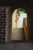 Arch and covered stair leading to the courtyard. Stock Photography
