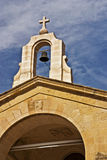 Arch Cross Bell. Upper part of stone Roman Catholic church in Malta featuring arch bell and cross Royalty Free Stock Image