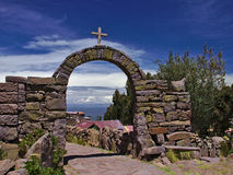 Arch Cross Lake. A view with an arch with a cross on at the Island of Taquile on Lake Titicaca Royalty Free Stock Photo