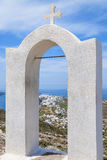 Arch with cross. In the landscape of Santorini, Greece Royalty Free Stock Photography